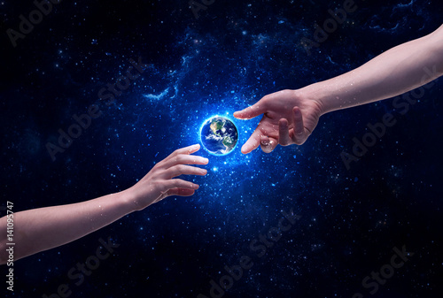 Hands in space touching planet earth