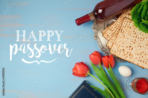 Jewish holiday passover pesah greeting card with seder plate matzoh jewish holiday passover pesah greeting card with seder plate matzoh and tulip flowers on wooden m4hsunfo
