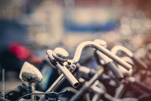 Poster photo of beautiful view on chain of cool bicycles on the parking