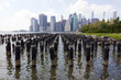Manhattan skyline from weathered dock piling in Brooklyn