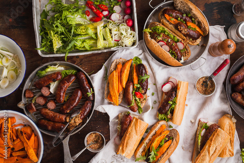 Grill Food party table concept. Grill Sausage Sandwiches with sweet potatoes fried and  sauce served on rustic table. Top view. - 141174579