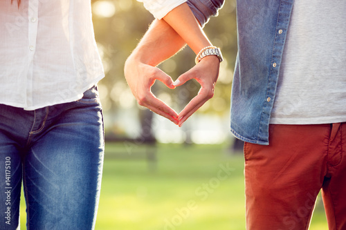 Couple in love showing heart