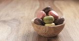 mixed macarons in wood bowl on table, 4k photo