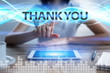 Woman using tablet pc, pressing on virtual screen and selecting thank you.