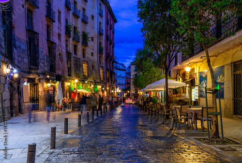 Night view of old cozy street in Madrid. Spain