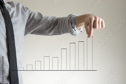 Businessman with growing chart concept