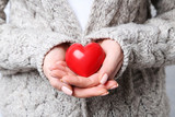 Woman holding red heart in hands
