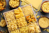 Different kinds of pasta on grey wooden table - 141228329
