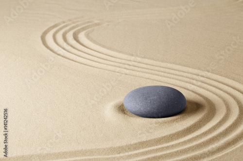 Foto op Canvas Zen Zen meditation stone garden background. Stone on fine sand standing for balance, harmony concentration and relaxation...