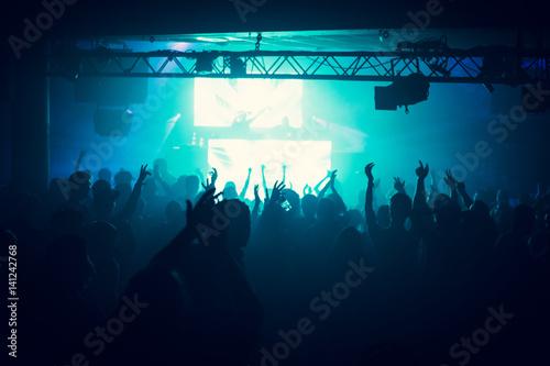 People dance on music in nightclub