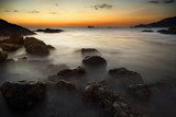 Dramatic seascape of rock and sea in the andaman ocean. Colorful summer sunset in phuket thailand.