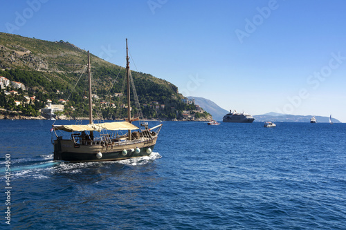 A ship leaving the marina of the Old Town Dubrovnik Poster