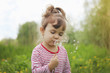 Girl with flowers in the spring outside. Selective focus.   - 141255740