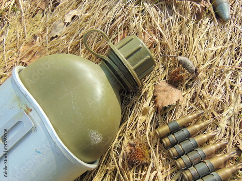 ammunition from World War 2 and drinking bottle Poster