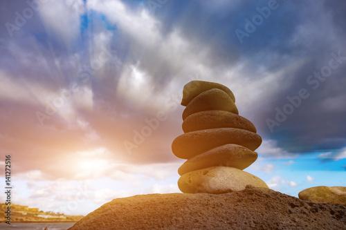 Sunset and stone pyramid
