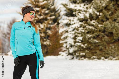Winter workout. Girl wearing sportswear and sunglasses.