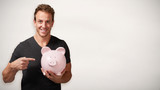 Smiling man with piggy bank.