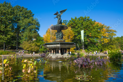 A beautiful Autumn day at the Angel of the Waters statue at Bethesda Terrace Poster