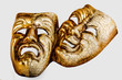 Two theatrical mask sadness and joy photographed on white background