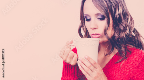Autumn woman holds mug with coffee warm beverage