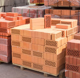 Perforated yellow and red bricks with round holes - 141318144