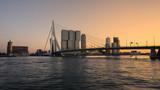 Erasmus bridge Rotterdam and skyline at sunset , the Netherlands