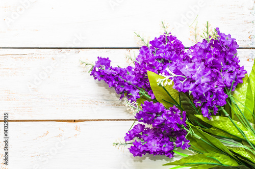 Lilac blossom, spring background, flowers located on wooden boards