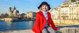 Fototapeta happy modern child on embankment in Paris, France relaxing