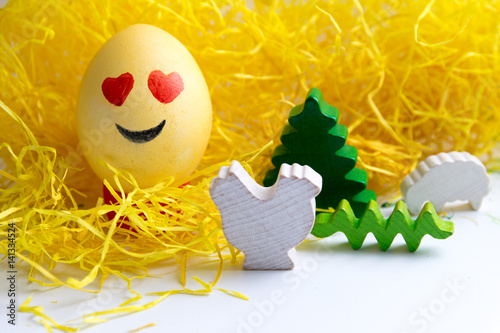 Poster Happy easter: emoji as easter egg in yellow gras - smiling face with heart shape