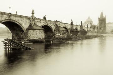 Misty morning in Prague near Charles bridge, old stylized photography.