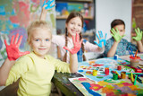 Kids having fun with paint on their palms - 141356934