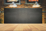 wood frame blackboard backgrounds with wood table top in the kitchen for product display , menu board with lamp and light on wall in restaurant - 141359761