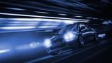 Fototapety Schnelles Auto bei Nacht in einer Stadt