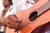 Fototapety Street musician playing traditional cuban music on an acoustic guitar for the entertainment of tourists in Trinidad, Cuba