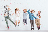Happy kids jumping - 141388757