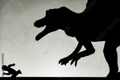 Poster shadow of spinosaurus chasing human  on wall no logo or trademark