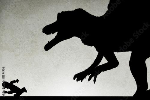 Poster shadow of spinosaurus chasing human  on wall no logo or trademark