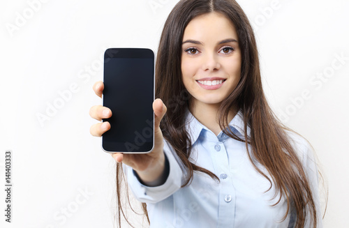 happy smiling woman showing mobile phone isolated in white background