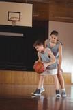 School kids playing basketball