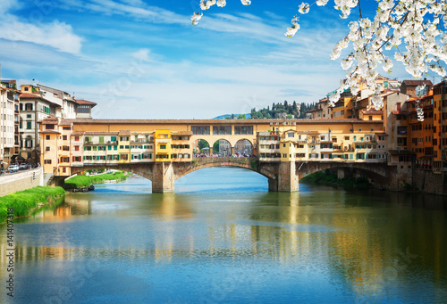 Poster famous bridge Ponte Vecchio over waters of river Arno, Florence at spring day, I