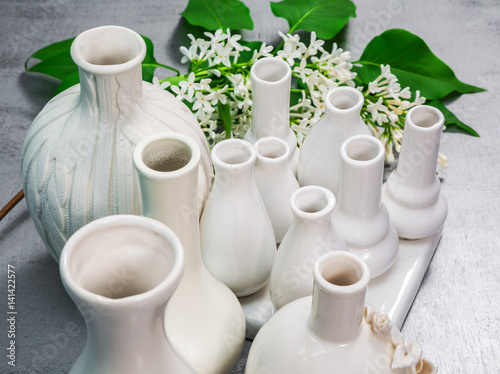 Porcelain vases with a branch of lilac