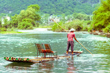 Local with Bamboo on Li river in Yangshuo China