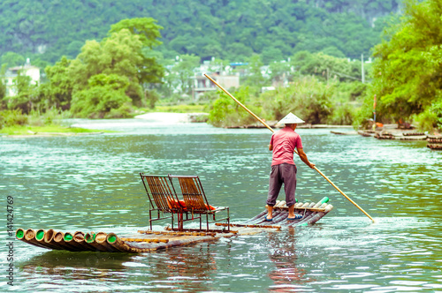 Foto op Canvas Guilin Local with Bamboo on Li river in Yangshuo China
