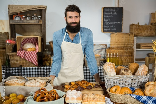 Portrait of male staff standing at bakery counter