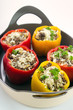 Stuffed bell peppers on ceramic oven dish closeup , vertical