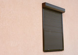 Window with rolling shutter and copy space.  Window with rolling shutter for house protection. - 141454550