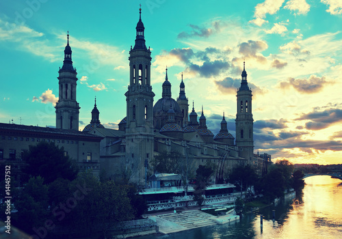 Cathedral of Our Lady of the Pillar and Ebro in evening. Zarago