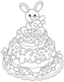 Festively decorated Easter cake with a small bunny and carrots