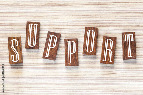 Support message formed with wooden tiles Poster