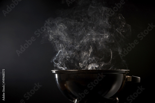 Smoke coming from a hot barbecue fire